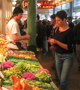 An attractive woman shops for vegetables.